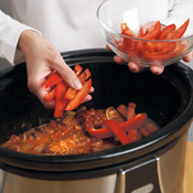 Add the peppers during the last 30 minutes of cooking so that they retain some texture.
