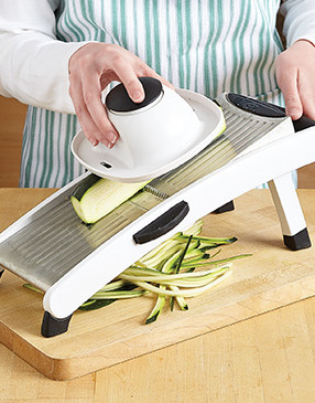 For the best texture, instead of shredding, julienne the zucchini on each side until you reach the seeds.