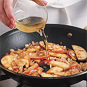 Once the apples have sautéed, stir in the apple juice and lemon juice and simmer until apples soften.