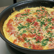 Layer the artichokes, prosciutto, Parmesan, and chives over the eggs. Bake frittata in oven 7–8 minutes. The center will not be set.
