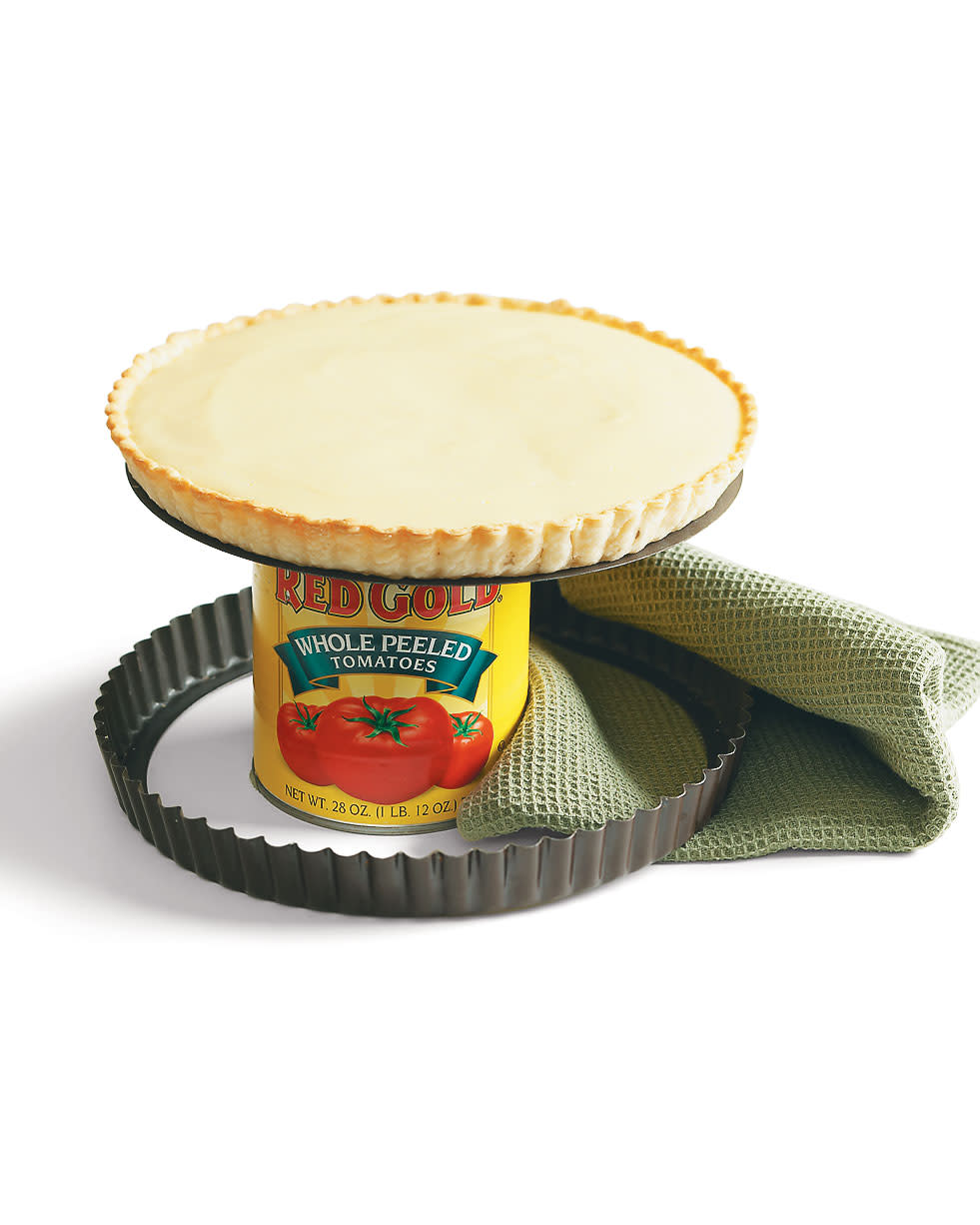 Easily separate a tart from its pan by setting the base on a large can to cool.