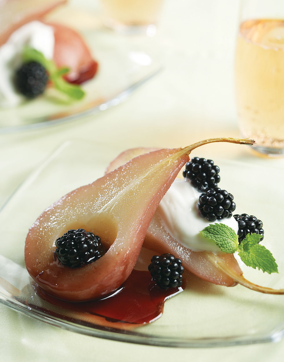 Wine-poached pears with vanilla-cinnamon sauce