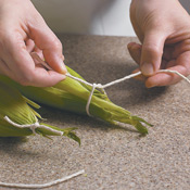 Gather and tie the husks back into place using a simple knot.