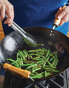 When blistering green beans, make sure that the oil and wok are hot enough before adding the beans. Then keep an eye on them, turning with tongs as they begin to blister.