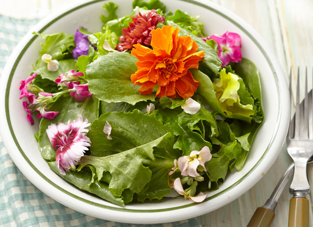 Which flowers are edible? All about identifying, buying, growing, and eating edible flowers.