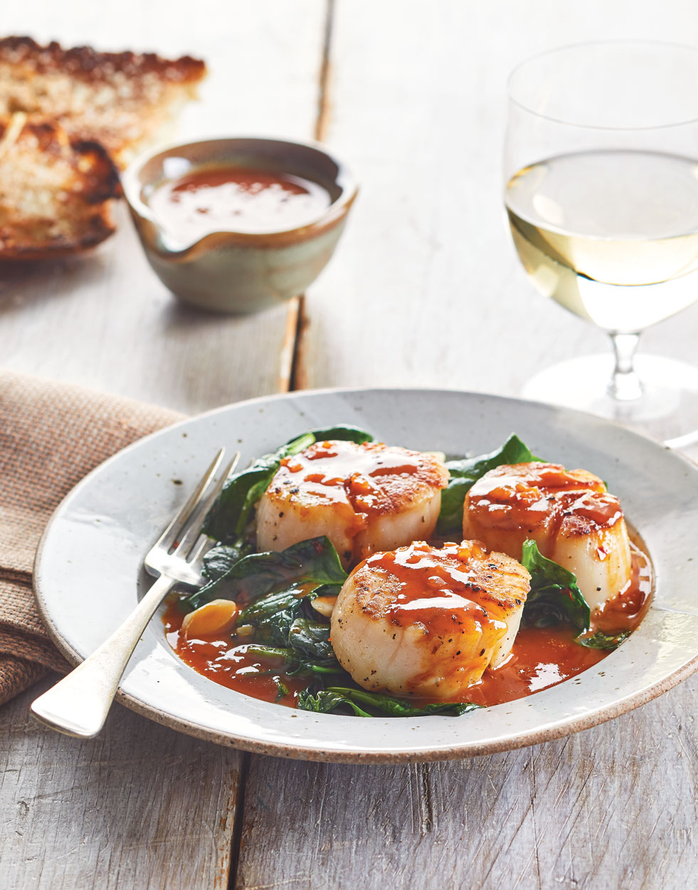 Cider Seared Scallops with Wilted Garlicky Spinach
