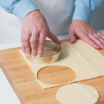Use a biscuit cutter or a large lid from a jar to cut puff pastry into 4–41/2-inch circles.