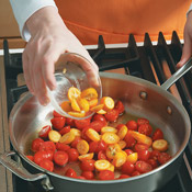 Sauté tomatoes and kumquats before adding vinegar and seasonings. Stir in scallions before serving.