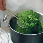 After boiling greens, use a slotted spoon to transfer them quickly to a bowl of ice water. Plunge greens in cold water for 1 minute to stop the cooking.