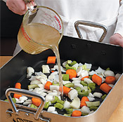 Adding broth to the vegetables keeps the turkey moist and adds flavor to the juices for the gravy.
