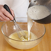 To prevent curdling, temper egg mixture by whisking in warm milk, then return to heat to thicken.