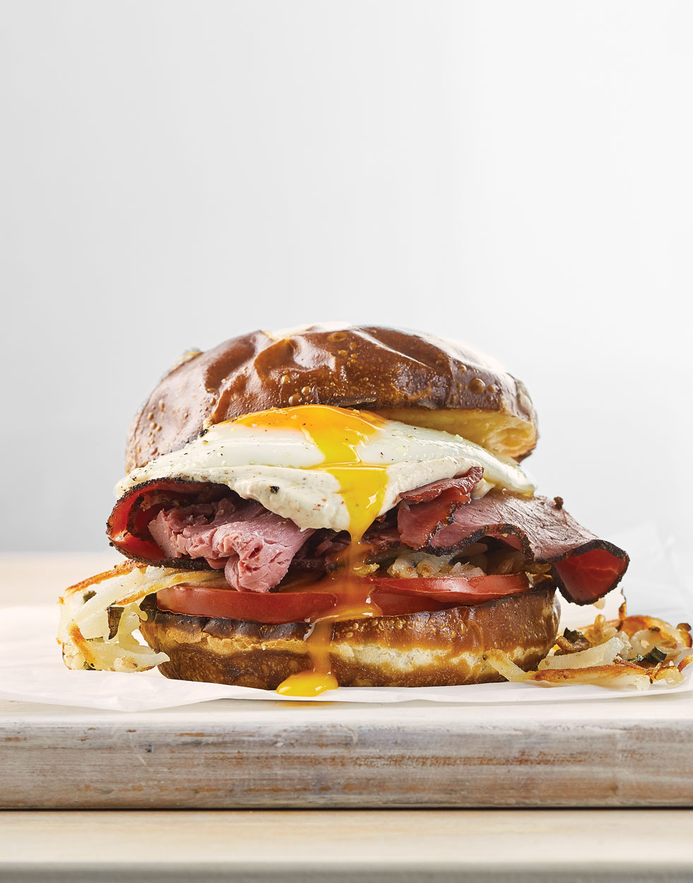 Pastrami & Egg Sandwiches with hash browns