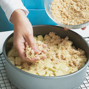 Sprinkle apple filling with streusel topping and bake until golden brown.