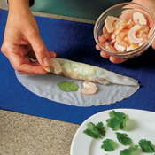Arrange the shrimp cut side up so the pretty side of the shrimp is visible when the roll is completed.