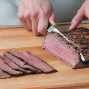 Slice the steak against the grain into tender, thin pieces. Divide steak slices evenly between tortillas.