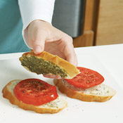Top the tomato with a pesto-covered slice of bread, then grill sandwiches until toasted.