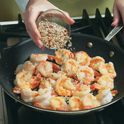 Combine the garlic and seasonings, then add them to the shrimp in the skillet; cook 1 minute to mellow the flavor of the garlic.