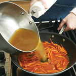Stir vinegar mixture into stir-fried vegetables and cook until thickened. Add broth and simmer briefly.