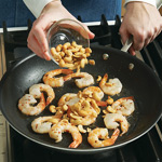 Cashews take the place of traditional peanuts in this soup. Stir-fry them with shrimp to toast lightly.