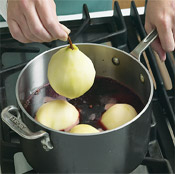 To ensure that the sugar dissolves thoroughly, heat the wine mixture before adding the pears.