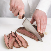 Slice the steak across the grain into thin strips to make it easier to eat when it's added to the salad.