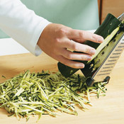 Shred zucchini down one side until you reach the seeds, then rotate to other side.