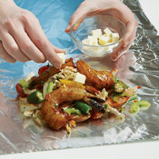 Arrange the vegetable mixture on the foil pieces, then top each serving with shrimp and butter. The butter will melt into a rich sauce.