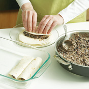 Roll 1/3 cup bean mixture into each torilla; lightly press the filling as you roll to the end.