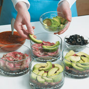 Layer the individual salads into bowls. Don't be too fussy; eyeballing the amounts for each layer is fine.