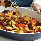 Gently toss the peaches and plums with syrup. Add the berries after baking so they don't break down too much.