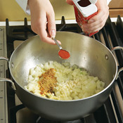 Add garlic, gingerroot, and spices to onion and sauté briefly to bring out the flavors of the spices.