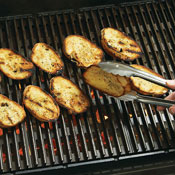 Grill slices of bread on both sides until toasted. Watch carefully to avoid burning the bread.