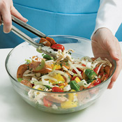 The sausage, chicken, and vegetables can be prepared up to one day ahead. Toss the mixture with garlic, oil, parsley, salt, and pepper before assembling the packets.