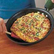 After removing frittata from the broiler, run a rubber spatula under the frittata to loosen it, then slide the frittata onto a cutting board.