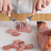 Slice turkey meat from the leg, then use two forks to shred it. One leg should yield 2 cups of meat.
