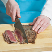 The steak will be easier to eat if it's thinly sliced against the grain. Cut the meat at an angle.