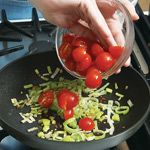 Add tomatoes to softened leeks and cook until tomatoes begin to break down and turn juicy.