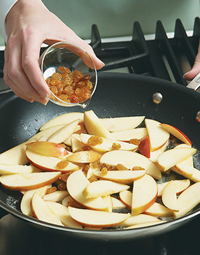Add raisins to the apples. Golden raisins look nice in the dish, but dark ones work fine too.