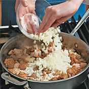 Sauté the chicken and sausage chunks with the onion in olive oil until browned.