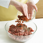 You must cook the bacon before mixing with the ground beef — otherwise, it'll be rubbery.