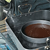 Bake the torte in a water bath inside a roasting pan to help protect its creamy, dense texture.