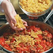 Add the tomatoes, pasta, and broth, stirring well to evenly distribute the noodles.