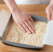 Press the shortbread mixture into an even layer in a pan lined with parchment paper.