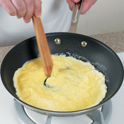 Shake the skillet while making stirring motions.