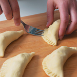 Fold pastry over the filling, press edges together, and crimp by pressing with a fork.