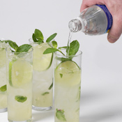After straining rum mixture into glasses, add ice and 4–6 ounces of club soda to each glass.