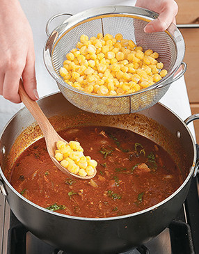 Since hominy is canned with lots of salt, be sure to drain and rinse it before stirring into the chili.