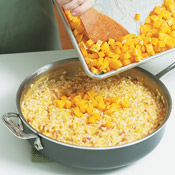 Remove the risotto from the heat. Stir in the reserved roasted squash, along with the fontina and herbs.