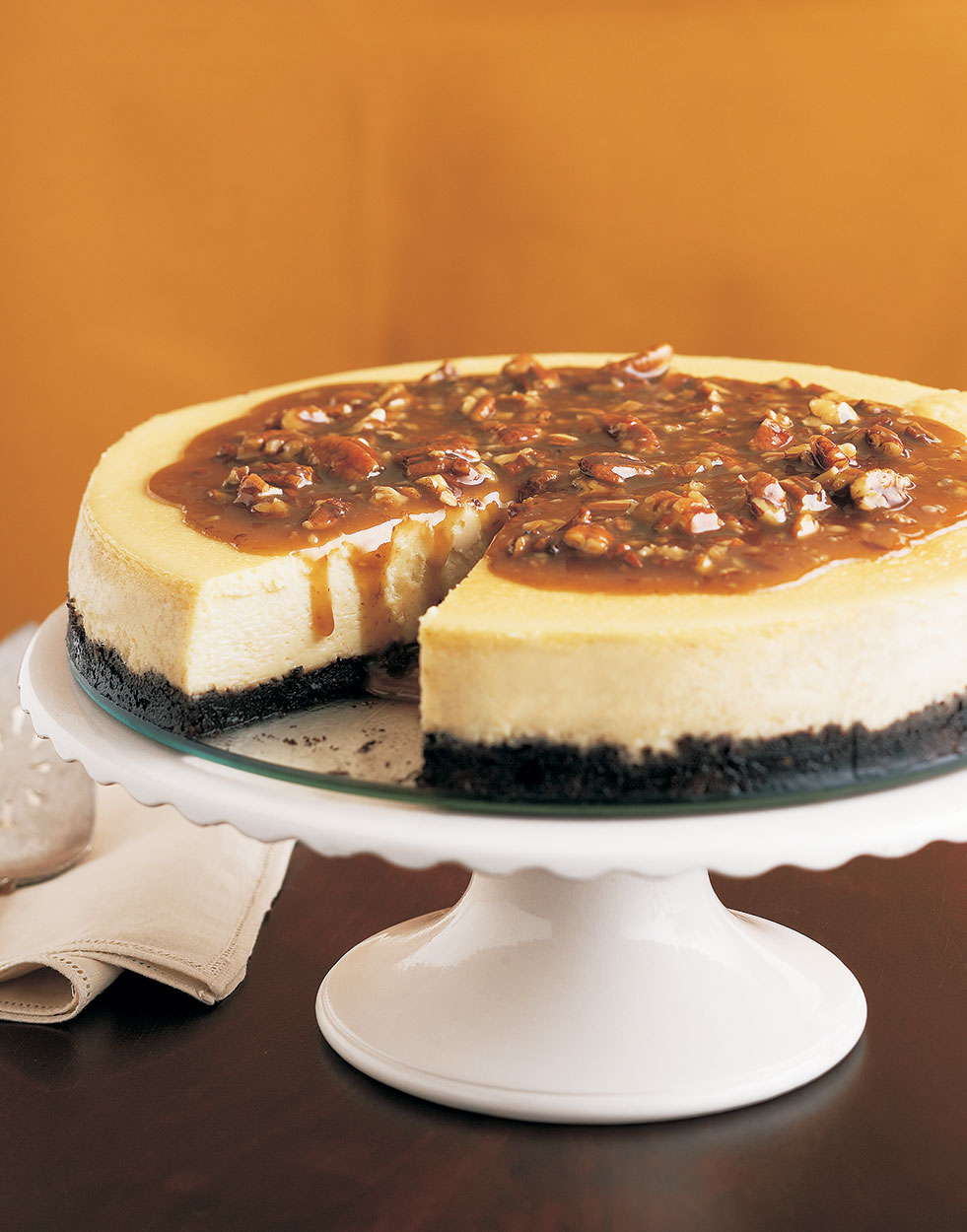 Pecan Pie Cheesecake with Caramel-Bourbon Sauce