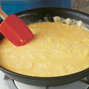 Wipe skillet clean after removing artichokes and prosciutto. Add eggs to skillet; stir and cook until curds form.